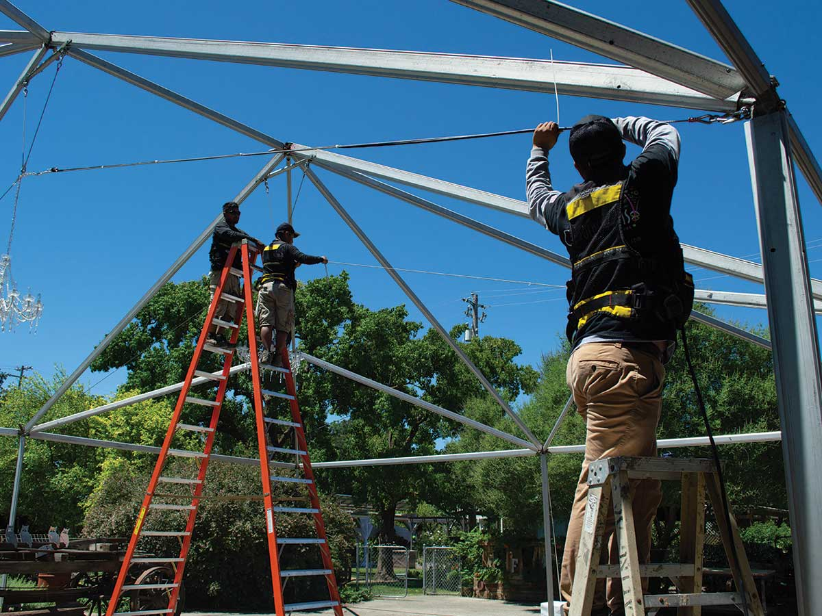 crew building tent frame