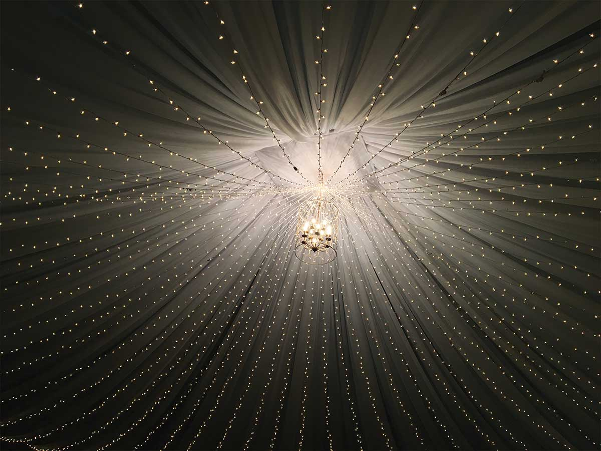 ceiling with draping and lights