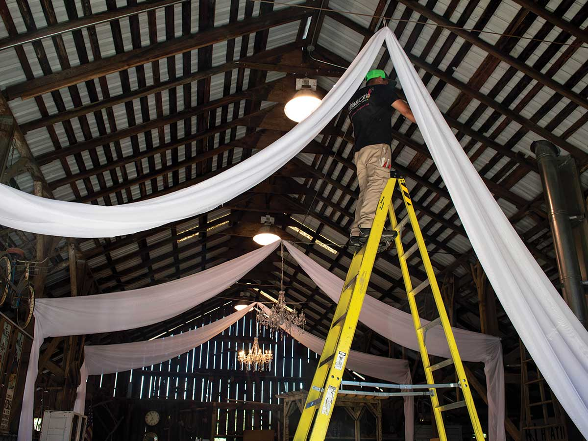 crew installing swagging in barn